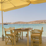 Beautiful scenic at Paros island in Greece with a greek traditional tavern against the sea. Royalty Free Stock Images