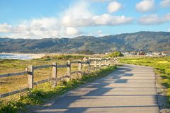 Beautiful scenic road on the green bluff above the ocean beach Stock Photos