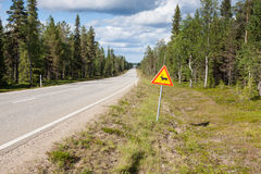 Beautiful scenic road in Norway. Typical warning road sign Stock Photography