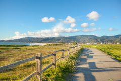 Beautiful scenic road on the green bluff above the ocean beach Royalty Free Stock Photo
