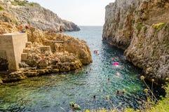 Beautiful scenic seascape at Ciolo Bridge, Salento, Apulia, Ital Stock Photos