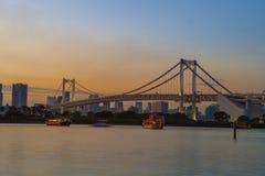 Beautiful scenic twilight time of rainbow bridge odaiba harbor t Stock Photo