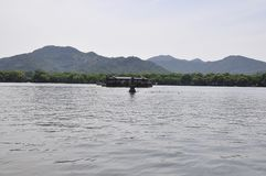 Scenic view area of the famous West Lake from Hangzhou. Beautiful scenic view area with traditional boat on from the West Lake in Hangzhou on 3rd may 2018 stock image