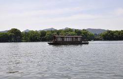 Scenic view area of the famous West Lake from Hangzhou. Beautiful scenic view area with traditional boat on from the West Lake in Hangzhou on 3rd may 2018 stock photography