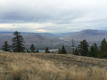 Beautiful scenic view of kamloops city from the top of mountain. Enjoying the beautiful scenic view of kamloops Stock Photography