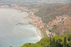 Beautiful Scenic View of the Sea, Green Forest, Taormina`s Old Town and Etna Volcano. The island of Sicily, Italy.  stock photos