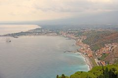 Beautiful Scenic View of the Sea, Green Forest, Taormina`s Old Town and Etna Volcano. The island of Sicily, Italy.  stock image