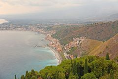Beautiful Scenic View of the Sea, Green Forest, Taormina`s Old Town and Etna Volcano. The island of Sicily, Italy.  stock photography