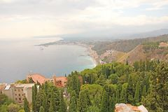 Beautiful Scenic View of the Sea, Green Forest, Taormina`s Old Town and Etna Volcano. The island of Sicily, Italy.  stock images
