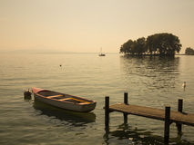 Beautiful scenic view of small island, boat and pier at Geneva l Stock Photography