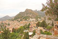 Beautiful Scenic View of Taormina`s Old Town. Terracotta Old Anc. Ient City Houses with Tiled Roofs. The island of Sicily, Italy royalty free stock photography