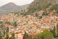 Beautiful Scenic View of Taormina`s Old Town. Terracotta Old Ancient City Houses with Tiled Roofs. The island of Sicily, Italy royalty free stock images