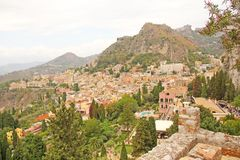 Beautiful Scenic View of Taormina`s Old Town. Terracotta Old Ancient City Houses with Tiled Roofs. The island of Sicily, Italy.  stock photography