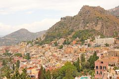 Beautiful Scenic View of Taormina`s Old Town. Terracotta Old Ancient City Houses with Tiled Roofs. The island of Sicily, Italy.  stock image