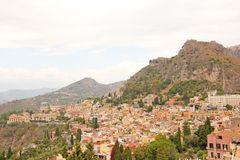 Beautiful Scenic View of Taormina`s Old Town. Terracotta Old Ancient City Houses with Tiled Roofs. The island of Sicily, Italy.  royalty free stock images