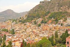 Beautiful Scenic View of Taormina`s Old Town. Terracotta Old Ancient City Houses with Tiled Roofs. The island of Sicily, Italy.  royalty free stock photos