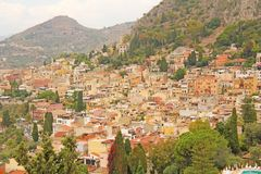 Beautiful Scenic View of Taormina`s Old Town. Terracotta Old Ancient City Houses with Tiled Roofs. The island of Sicily, Italy.  royalty free stock photo