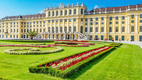 Beautiful Schonbrunn Palace with colorful flowerbed Vienna, Austria Royalty Free Stock Images
