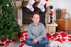 Beautiful school boy with  Christmas tree and decoration Stock Photo