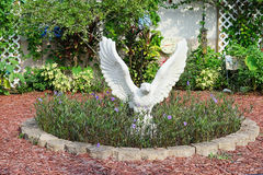A beautiful school garden and a white statue of eagle Royalty Free Stock Image