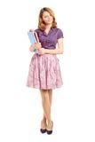 Beautiful school girl holding books Royalty Free Stock Image