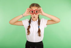 Beautiful school girl holding two insulating tape on eyes Royalty Free Stock Images