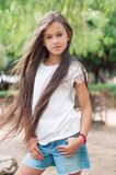Beautiful school girl with long hair in the park.  Prety Girl wi Royalty Free Stock Photo