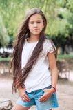 Beautiful school girl with long hair in the park.  Prety Girl wi Stock Images