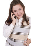Beautiful school girl talking on mobile phone Royalty Free Stock Images