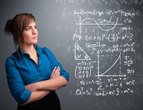 Beautiful school girl thinking about complex mathematical signs Stock Photography