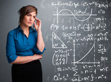 Beautiful school girl thinking about complex mathematical signs Stock Photo
