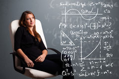 Beautiful school girl thinking about complex mathematical signs. Beautiful young school girl thinking about complex mathematical signs Royalty Free Stock Photo