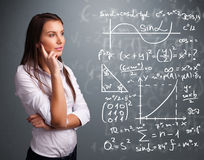 Beautiful school girl thinking about complex mathematical signs Stock Photos
