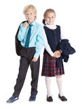 Beautiful schoolchildren with jackets in hands standing together full length, isolated white background Royalty Free Stock Images