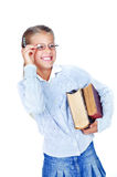 Beautiful schoolgirl in glasses with books. Stock Photography