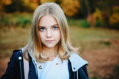 Beautiful schoolgirl outdoor. A beautiful young girl outside. Autumn fashion, beauty royalty free stock photography