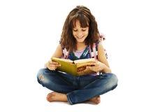 Beautiful schoolgirl sitting on floor studying Stock Photography