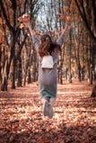 Beautiful schoolgirl walks in the autumn park royalty free stock photos