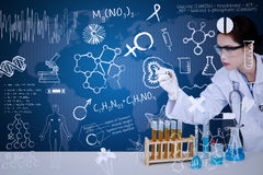 Beautiful scientist drawing on blue background Royalty Free Stock Photography