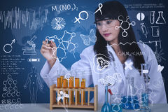 Beautiful scientist drawing formula at lab Royalty Free Stock Photos