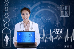 Beautiful scientist hold laptop on blue background Royalty Free Stock Images