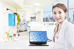 Beautiful scientist and laptop at hospital Royalty Free Stock Image