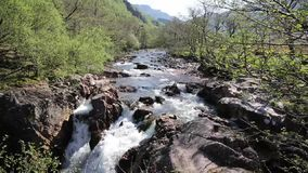 Beautiful Scottish Highlands Glen Nevis river Scotland UK with white water rocks and mountains stock video footage