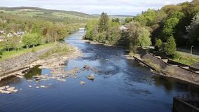 Beautiful Scottish river Pitlochry Scotland UK River Tummel in Perth and Kinross a popular tourist destination pan. Pitlochry Scotland UK view of River Tummel in stock footage