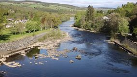 Beautiful Scottish river Pitlochry Scotland UK River Tummel in Perth and Kinross a popular tourist destination pan. Pitlochry Scotland UK view of River Tummel in stock video footage