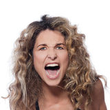 Beautiful screaming curly hair Woman. Beautiful caucasian woman angry portrait isolated studio on white background Stock Photos