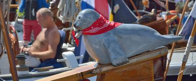Beautiful sculpted blue seal on a bow of a ship Stock Photo