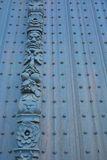 Beautiful sculpture , detail from an ancient door Royalty Free Stock Photo