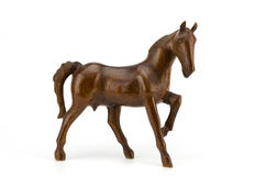 Beautiful sculpture of horse made of  wood isolated on the white. Background Royalty Free Stock Photos