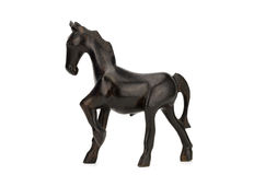 Beautiful sculpture of horse made of  wood isolated on the white. Background with clipping path Stock Photography
